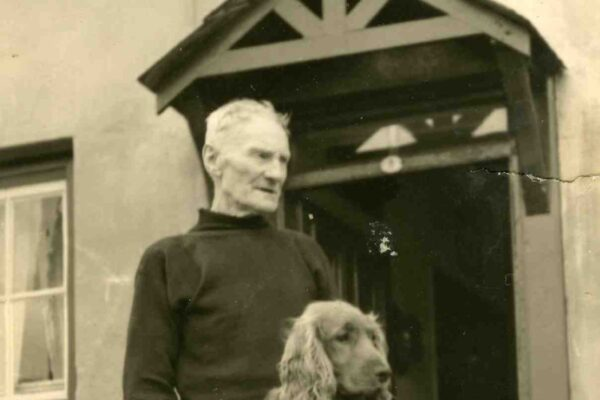Grandfather Tom Grills with dog Paddy