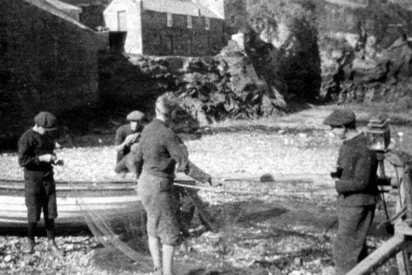 Tending the nets, c1925