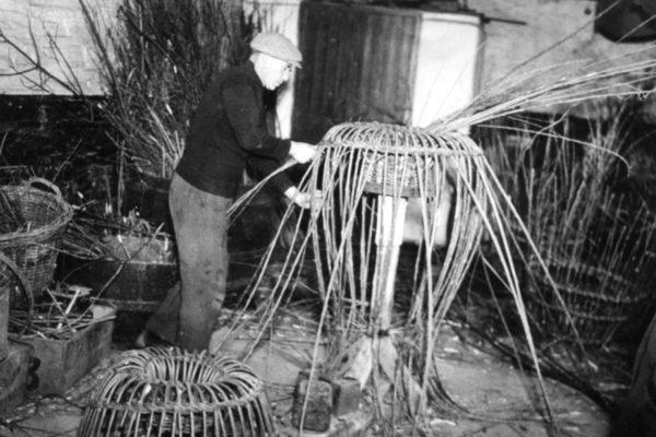 Tom Brown making lobster pots, c1955